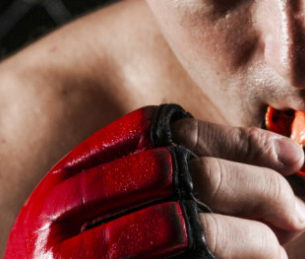 Sweaty boxer putting in sports guard from Hamilton dentist