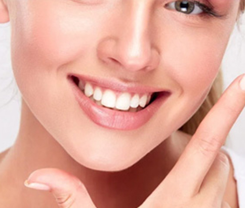 Charming girl's smile restored by gum reshaping in hamilton