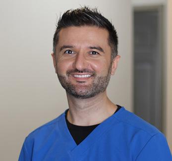 Friendly dentist working at hamilton dental clinic