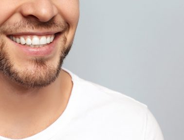 Man with goatee shows off bright smile free of gum disease